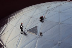 2 workers outside an aluminium dome roof
